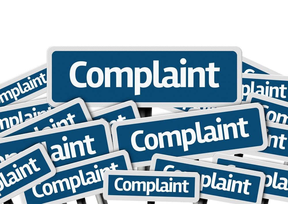 Complaint written on multiple blue road sign