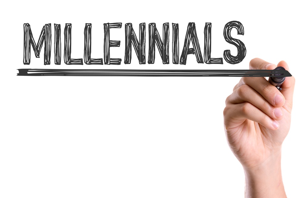 Hand with marker writing the word Millennials