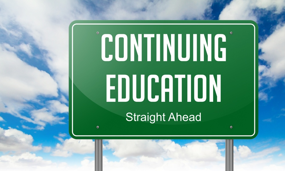 Highway Signpost with Continuing Education wording on Sky Background..jpeg