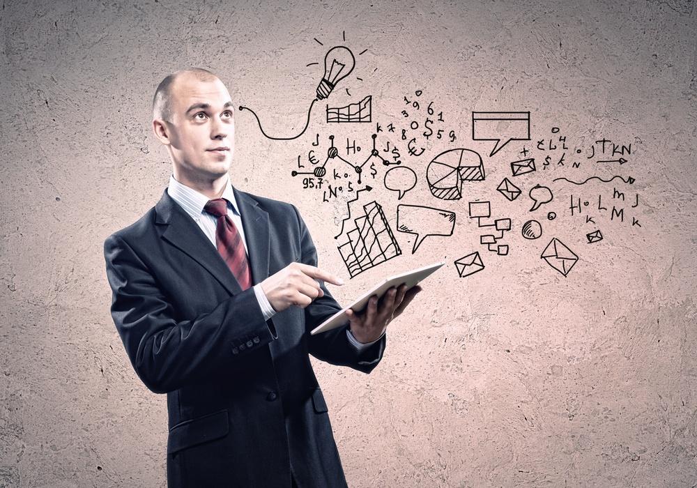 Image of businessman holding tablet in hands