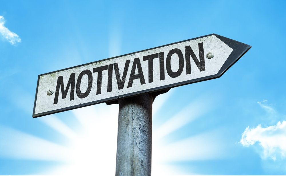 Motivation sign with a beautiful day