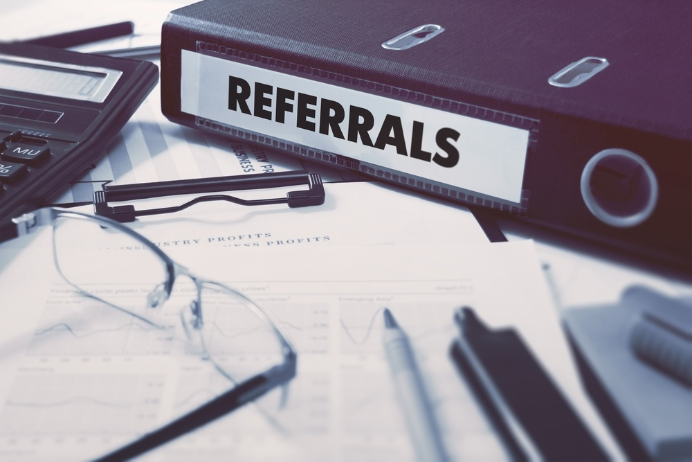 Referrals - Ring Binder on Office Desktop with Office Supplies. Business Concept on Blurred Background. Toned Illustration..jpeg