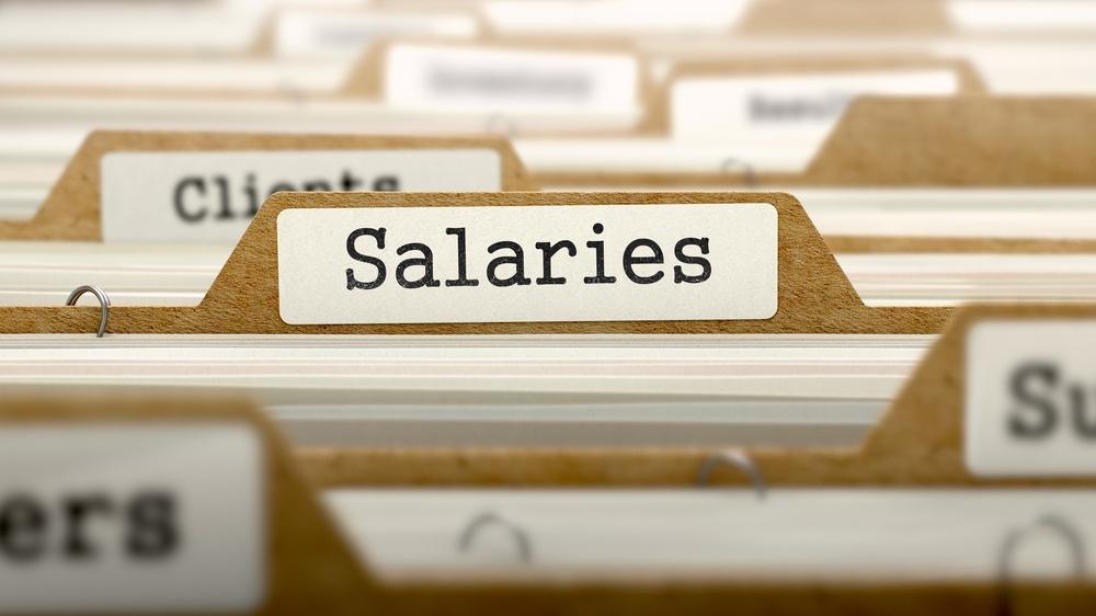 Salaries Concept. Word on Folder Register of Card Index. Selective Focus.