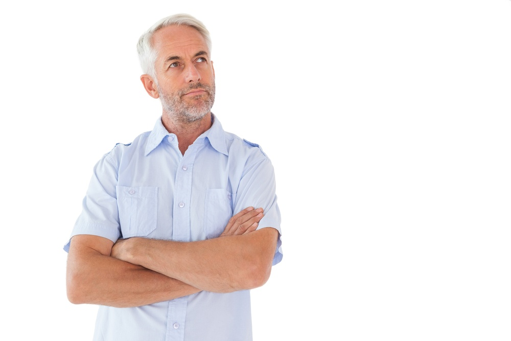 Thinking man posing with arms crossed on white background