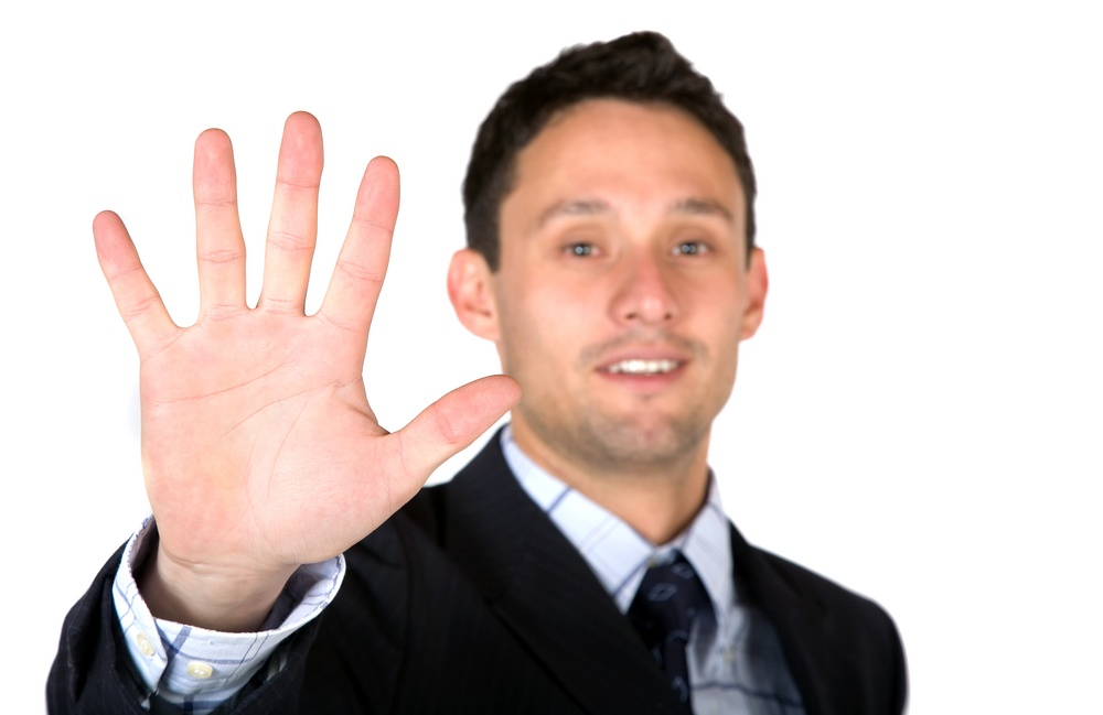 business man showing his hand over a white background (shallow DOF)